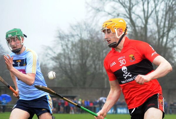UCC's Mark Kehoe soloing goalwards chased by UCD's Ian O'Shea. Picture: Denis Minihane.