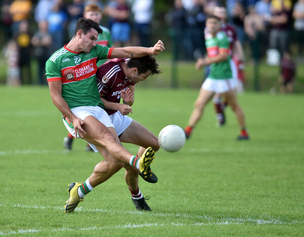 Clonakilty's Tom Clancy is tackled by Bishopstown's Jamie O'Sullivan. Picture: Eddie O'Hare