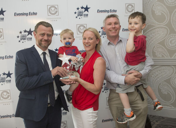 Eoin Daly, general manager, Ambassador Hotel, sponsors making the presentation to Jill Hodgins, Athletics. Also included are her family John, Andrew and Daniel. Picture Dan Linehan