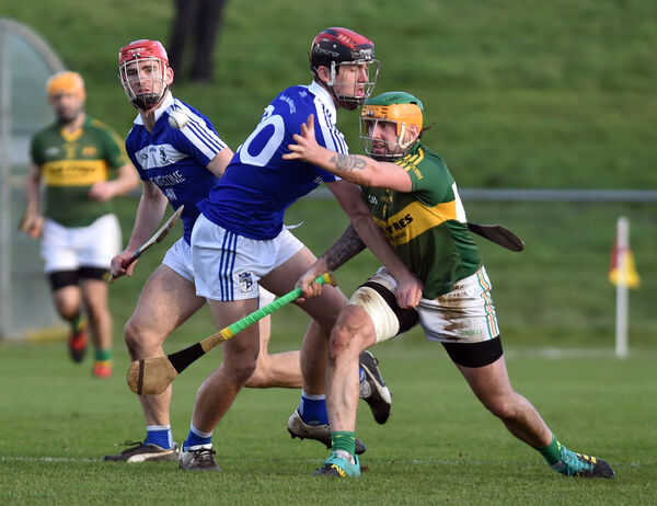 Cloughduv's Dave O'Leary gets off his pass from Ballinameela's Mikey Phelan. Picture: Eddie O'Hare