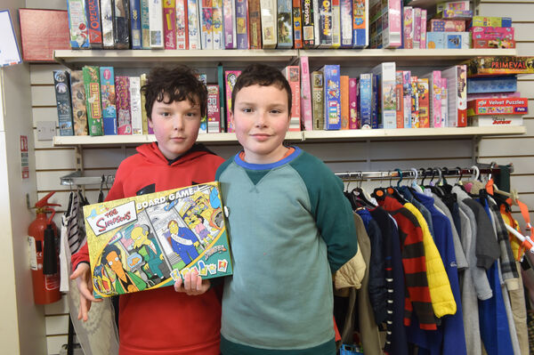 Noah and Oscar at the NCBI shop getting some second hand goods. Picture: Dan Linehan