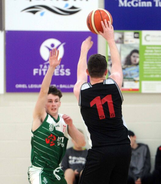 Limerick IT's Daniel Broderick trying to block a shot by Ballincollig's Ciaran O'Sullivan. Picture: Denis Minihane.
