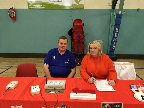 Denis O'Gorman with Norma Thompson, table officials at a National League game recently.