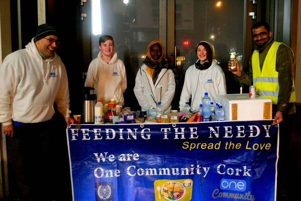 HELPING HAND: One Community Cork offering food for the homeless, including Ali Hamou (left) and Sam Waldron (second left). Picture: Shamim Malekmian