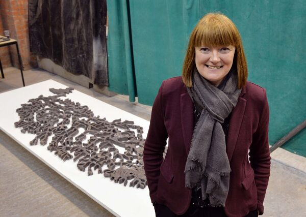 Valerie Byrne, director, National Sculpture Factory, Cork, against the backdrop of a cast iron sculpture from an aerial view of the River Lee by artist Tamsie Ringler from a project called Iron-R.Picture Denis Minihane