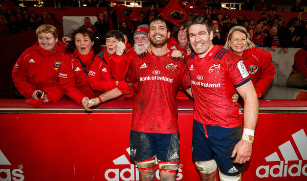 Munster's Billy Holland celebrates after the game with the choir and Jean Kleyn. Picture: INPHO/Tommy Dickson