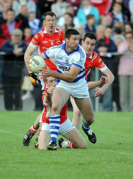 Castlehaven's Bernie Collins gets away from O'Donovan Rossa's Kevin Cotter and Conor McCarthy. Picture: Eddie O'Hare