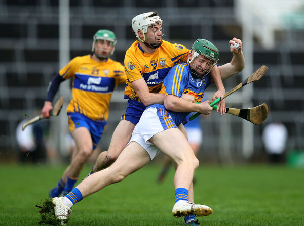 Clare's Ryan Taylor and Robert Byrne of Tipperary. Picture: INPHO/Ryan Byrne