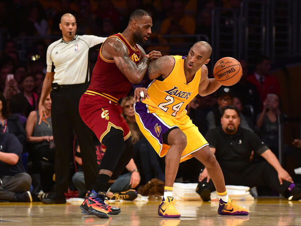 TWO OF THE GREATS: Kobe Bryant backs in on LeBron James. Picture: Harry How/Getty Images