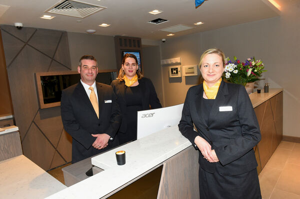 Hotel reception staff John Delea; Katie Clancy, supervisor and (front right) Sarah Wallace-Condon, reception manager at the Maldron Hotel, South Mall. Pic; Larry Cummins
