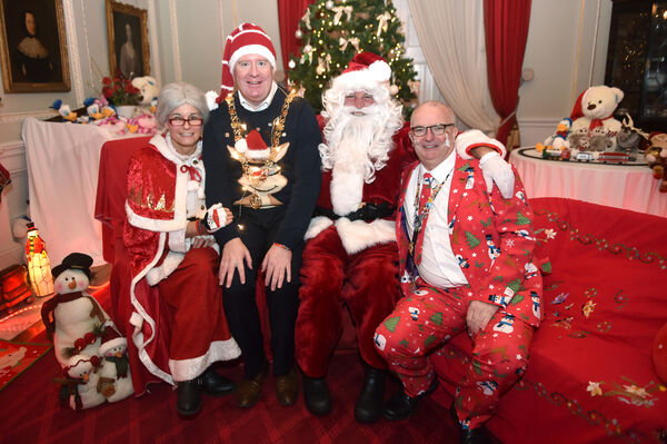 Santa and Mrs. Claus with the Lord Mayor of Cork, Cllr. Mick Finn and John Looney, Chairperson at the annual Cork City Hospitals Children's Club annual Christmas day out to the magical winter wonderland at Fota House. Picture Dan Linehan