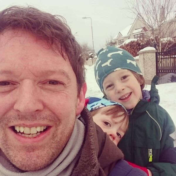 Stephen Teap with his two children, during the snow this year.