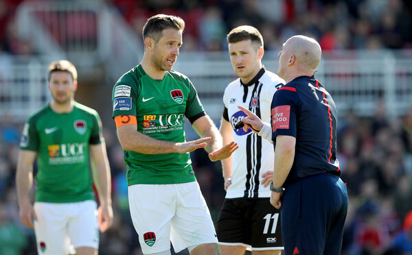 Alan Bennett with referee Robert Rogers. Picture: INPHO/Ryan Byrne