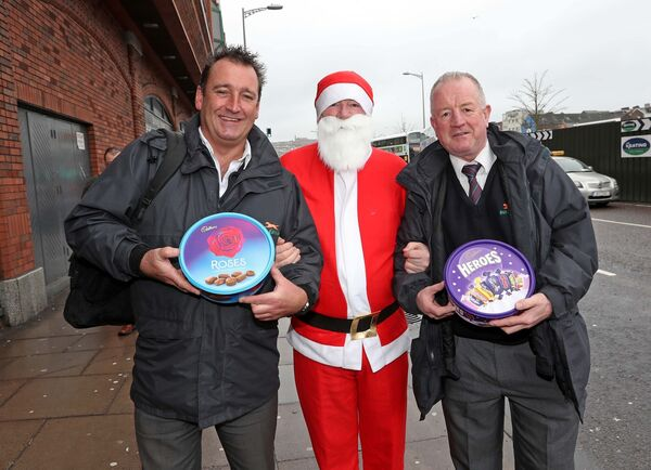 Retired Bus driver, Michael Howick, as Santa with bus drivers, Paul Creedon and TJ Collins. Picture: Jim Coughlan
