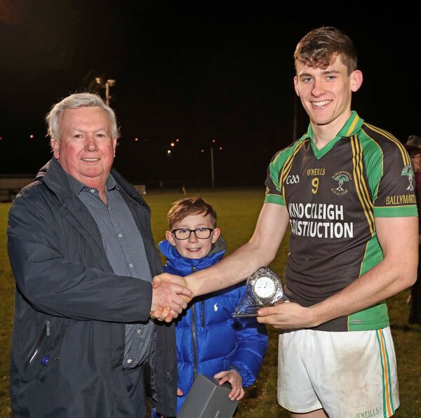 Paddy Fitzgerald and Cillian Fitzgerald, present the Man of the Match Trophy to Jack Ryan. Picture: Jim Coughlan.