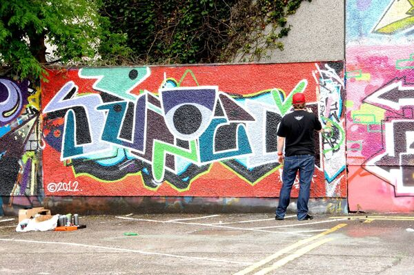 One of the artists at work during the Noho Hip Hop Festival Graffiti display in White Street car park in 2012. Picture: Richard Mills.
