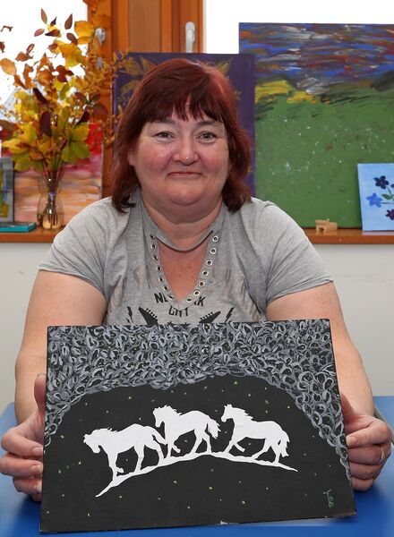 TALENTED: Artist Mary McCarthy, from The Glen, with one of her pieces which will feature in the Shine a Light Art Sale fundraiser in conjunction with ABLES adult literacy programme in The Glen. Picture: Jim Coughlan