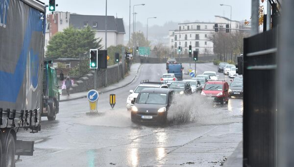 Cars making their way through the floodwater in Blackpool, Cork after heavy rain. Picture Dan Linehan