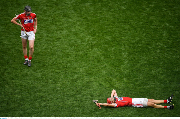 Damien Cahalane, left, and Bill Cooper were shattered after. Picture: Brendan Moran/Sportsfile
