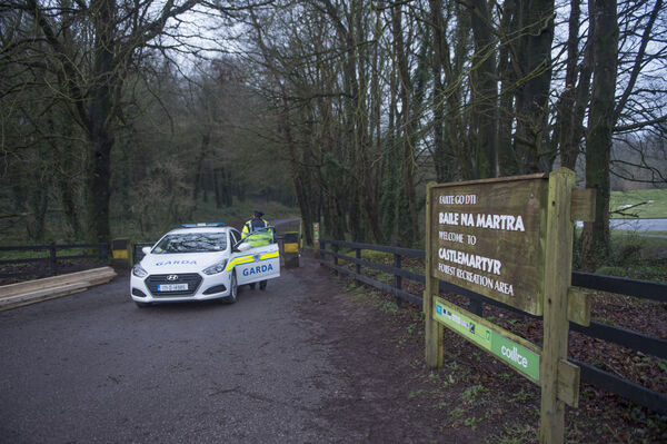 Gardai at the entrance to Mitchel's Wood in Castlemartyr, where a search took place for Tina Satchwell. Picture Dan Linehan