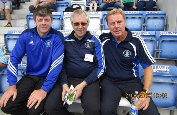 Castlehaven senior football manager Liam Collins and club stalwart Batt Maguire pictured with Harry Redknapp who managed the senior football team against Erin's Isle.