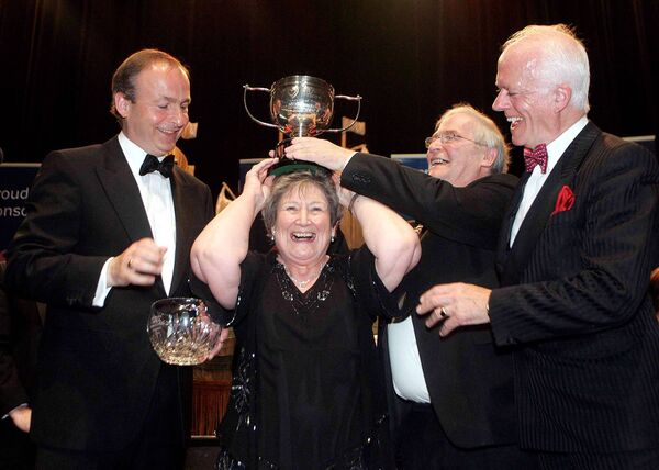 TIMES PAST: Back in 2009, Minister Micheál Martin, Lord Mayor Brian Bermingham and organiser Paddy O'Brien presenting Mary Conway, from Whithchurch, with the winning trophy in the over 60's final.