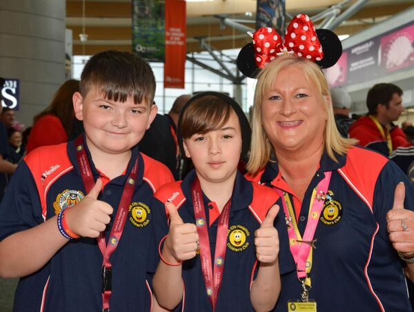 Volunteer Avril Corcoran, right, pictured with Alex Stack, Togher and Darragh McAulliffe from Ballyphehane at Cork Airport prior to the Cork City Hospital Childrens Club's annual visit to Eurodisney. Picture: Howard Crowdy