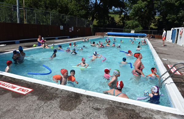 The community run outdoor swimming pool at Carrignavar (Carrig na BhFear) packed with swimmers enjoying the summer sunshine.Picture: Eddie O'Hare