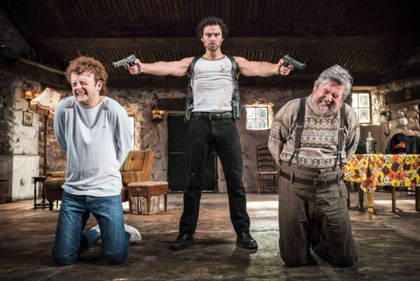 Chris Walley (left) in Martin McDonagh's play The Lieutenant of Inishmore with Aidan Turner and Denis Conway. Picture Johan Persson.