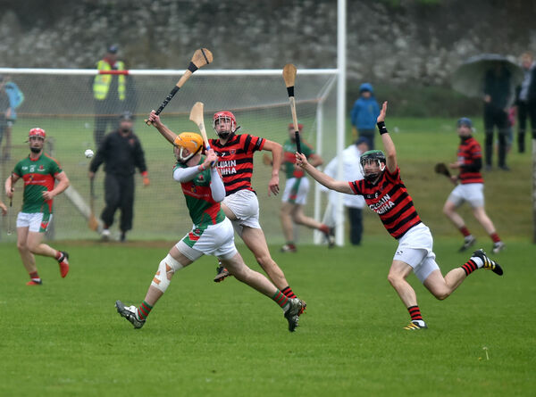 Fr O'Neills Declan Dalton shoots from Cloyne's Maurice Lynch and Brian Minihane. Picture: Eddie O'Hare