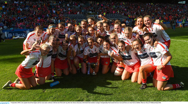 Sarah Harrington and her teammates with the Jack McGrath Cup. Picture: Piaras Ó Mídheach/Sportsfile