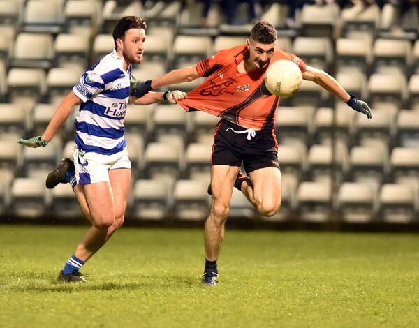 Duhallow's Seamus Hickey is held by Castlehaven's Steven Collins. Picture: Eddie O'Hare
