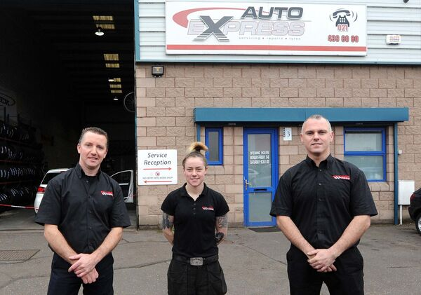 Aoife Murray, apprentice technician at Auto EXpress, City North Business Park, Dublin Hill, Cork, pictured with William O'Donovan (left) and John Buckley, co-owners.Picture Denis Minihane.