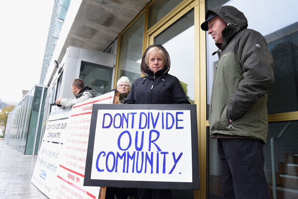 Waterloo Access Group took their campaign to Cork County Hall to highlight the issue regarding the closure of the Waterloo junction on the N20 Cork-Mallow Road. Margaret Reidy with the message 'Don't divide our community'. Pic; Larry Cummins