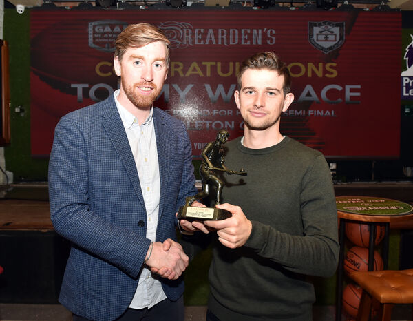 Michael O'Sullivan presents Tommy Wallace with his award. Picture: Eddie O'Hare