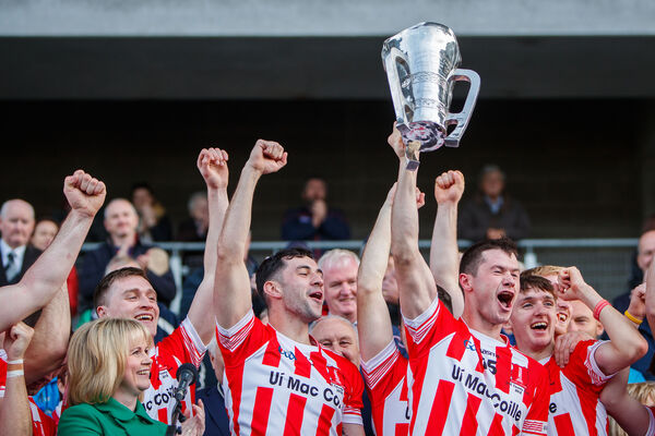 Imokilly's Seamus Harnedy lifts the trophy presented by Tracey Kennedy. Picture: INPHO/Oisin Keniry