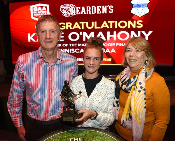 The Rearden's Player of the Match Award for the camoge final Katie O'Mahony of Inniscarra with parents Frank and Betty. Picture: Larry Cummins