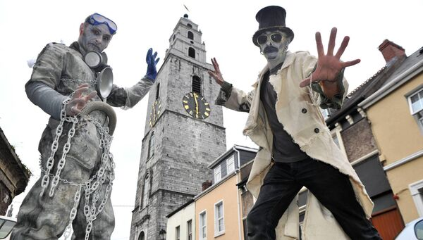 Sam Hamilton and William Frode de la Foret near O'Connell Place, Cork for the launch of the dragon of Shandon Samhain Parade in 2011. Picture Dan Linehan