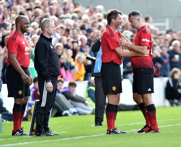 United's Roy Keane comes on to replace Ryan Giggs at the Liam Miller tribute match. Picture: Eddie O'Hare