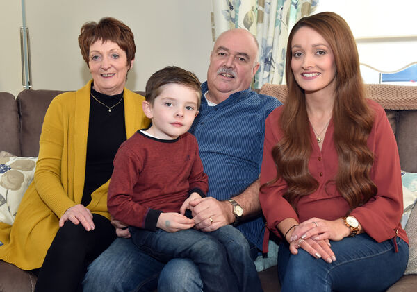 Trevor Laffan with his wife Gaye, daughter Vicki and grandson Cooper at home in Cobh Picture: Eddie O'Hare