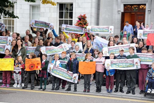 Some of those taking part in a show of support outside City Hall, prior to a meeting of Cork City Council, for Gaelscoil an Ghoirt Álainn, Mayfield, by parents, pupils, family members and staff of the school in relation to the construction of the new school building. Picture: Denis Minihane.
