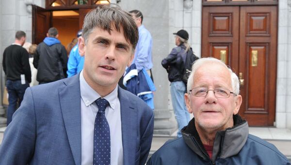 Deaglán Ó Deargáin, school principal, (left) and Bertie Dorgan, school caretaker, at a show of support outside City Hall, prior to a meeting of Cork City Council. Picture: Denis Minihane.