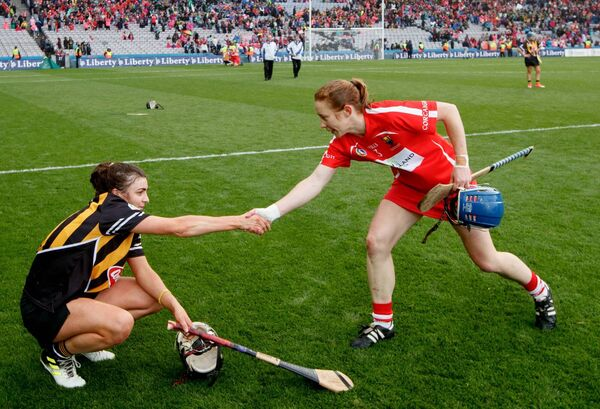 Kilkenny captain Anna Farrell and Cork captain Rena Buckley last year. Picture: INPHO/James Crombie