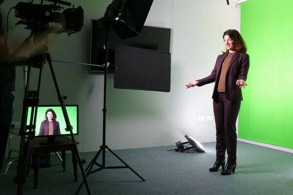 Services offered include a green screen in the studio.