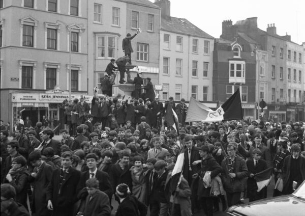 RN Coláiste Chríost Rí supporters display the Harty Cup from the top of the Berwick on Grand Parade after their victory over Limerick CBS in 1968