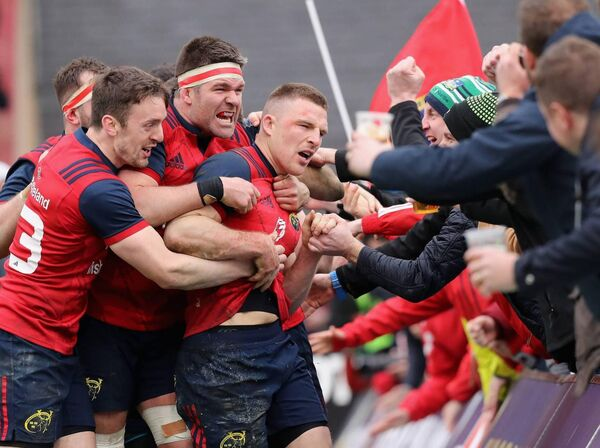 Andrew Conway of Munster celebrates with team mate and the crowd after scoring a crucial late second half try during the European Rugby Champions Cup match between Munster Rugby and RC Toulon at Thomond Park on March 31, 2018 in Limerick, Ireland. (Photo by David Rogers/Getty Images)