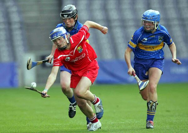 Rena is pursued by Claire Grogan and Angie McDermott of Tipperary in the 2005 All-Ireland final. Picture: INPHO/Lorraine O'Sullivan