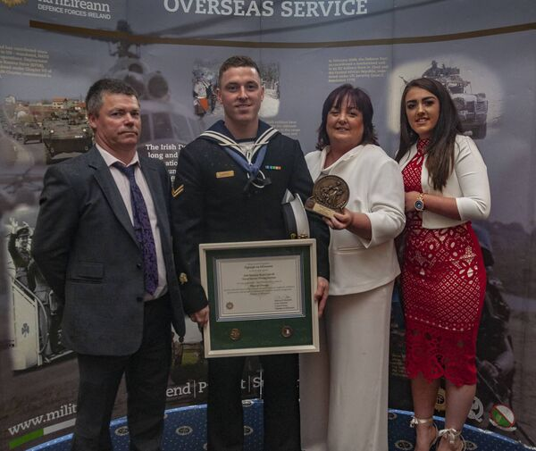 Leading Seaman Ryan Carroll from Passage West pictured with his father Paddy, his mother Samantha and sister Abby.
