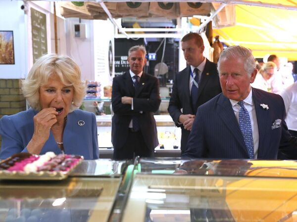 The Prince of Wales and the Duchess of Cornwall during a visit to the English Market in Cork. Picture: Steve Parsons/PA Wire