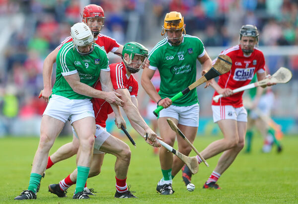 Limerick's Cian Lynch and Seamus Harnedy of Cork. Picture: INPHO/James Crombie